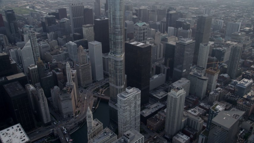 5K stock footage aerial video tilting from Chicago River to reveal Trump Tower Chicago and Willis Tower in distance, Downtown Chicago, Illinois Aerial Stock Footage | AX0001_040