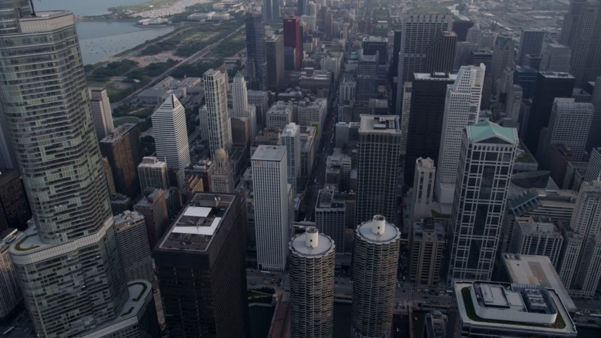 5K stock footage aerial video fly by of Trump International, then tilt down to reveal Marina City, Downtown Chicago, Illinois Aerial Stock Footage | AX0001_041