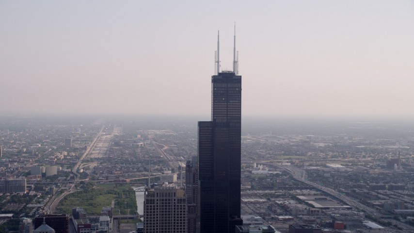 5K stock footage aerial video orbiting Willis Tower, hazy day, Downtown Chicago, Illinois Aerial Stock Footage | AX0001_042