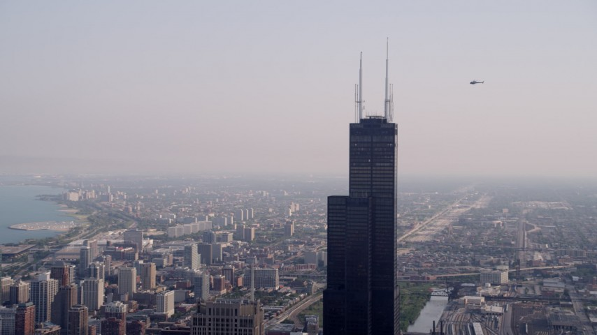 5K stock footage aerial video orbiting the top of the Willis Tower on a hazy day, Chicago, Illinois Aerial Stock Footage | AX0001_043