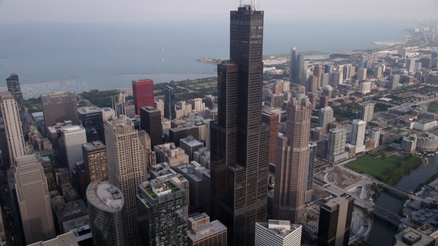 5K stock footage aerial video tilt from the Chicago River to reveal Willis Tower in Downtown Chicago, Illinois Aerial Stock Footage | AX0001_045