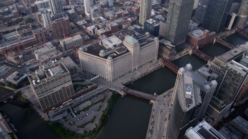 5K stock footage aerial video pan from Merchandise Mart across the Chicago River, Downtown Chicago, Illinois Aerial Stock Footage | AX0001_046