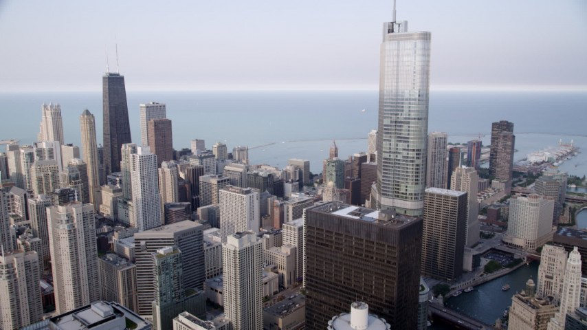5K stock footage aerial video following the Chicago River, tilt up revealing Trump Tower and John Hancock Center, Downtown Chicago, Illinois Aerial Stock Footage | AX0001_048
