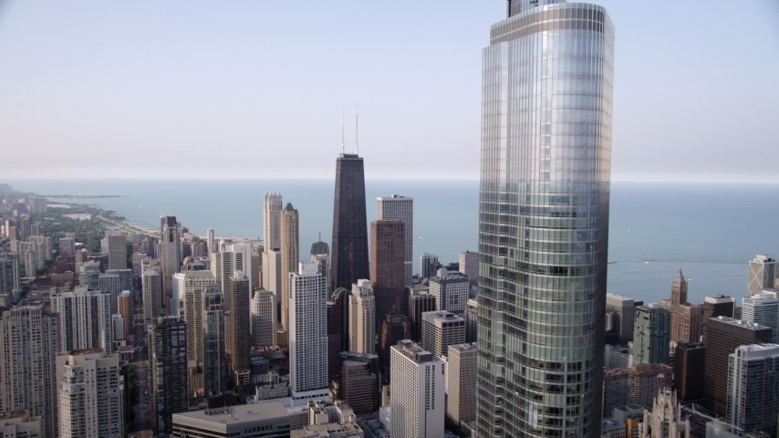 5K stock footage aerial video flyby Trump Tower Chicago with a view across downtown at John Hancock Center, Downtown Chicago, Illinois Aerial Stock Footage | AX0001_049