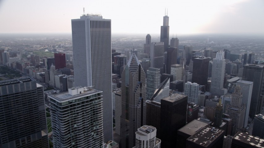 5K stock footage aerial video orbiting Aon Center and Two Prudential Plaza, on a hazy day, Downtown Chicago, Illinois Aerial Stock Footage | AX0001_050