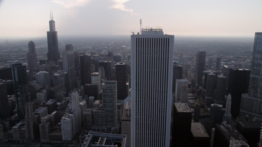 5K stock footage aerial video Orbiting Aon Center, with Downtown Chicago skyscrapers in the background, Illinois Aerial Stock Footage | AX0001_051