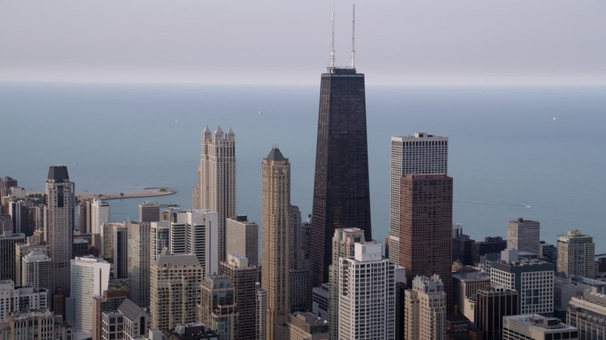 5K aerial  video of John Hancock Center in Downtown Chicago on a hazy day, Illinois Aerial Stock Footage | AX0001_054