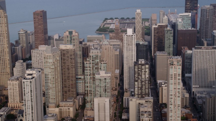 5K stock footage aerial video flying by a group of high-rises and skyscrapers, Downtown Chicago skyscrapers, Illinois Aerial Stock Footage | AX0001_055