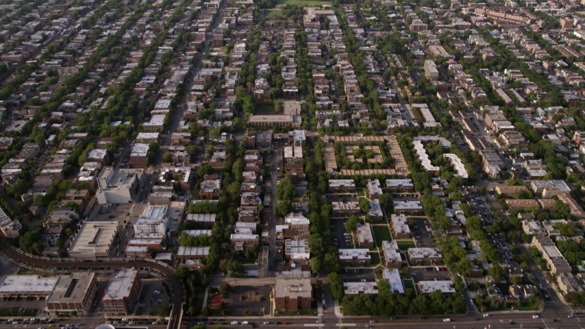5K aerial stock footage video tilt from homes in the North part of Chicago to reveal apartment buildings, on a hazy day, Chicago, Illinois Aerial Stock Footage | AX0001_057