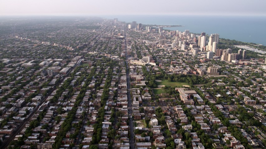5K aerial stock footage video of neighborhoods and apartment buildings in North Chicago, on a hazy day, Illinois Aerial Stock Footage | AX0001_058