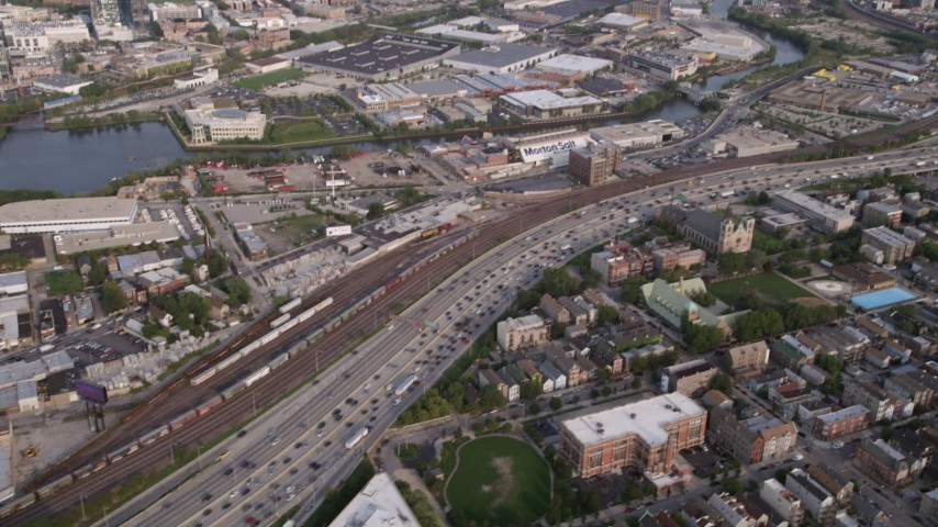 5K stock footage aerial videov from heavy traffic on Interstate 90 and 94, and reveal Downtown Chicago skyline on a hazy day, Illinois Aerial Stock Footage AX0001_061 | Axiom Images