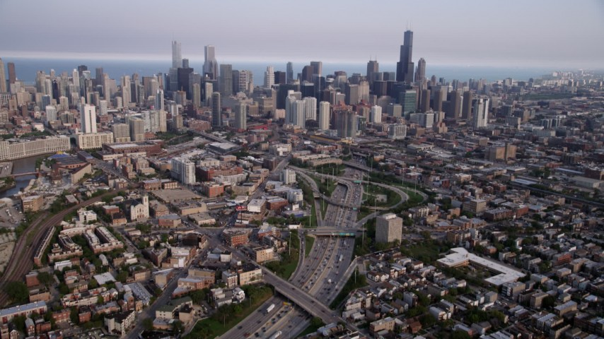 5K aerial video tilt from streets by Interstate 90 and 94, revealing downtown skyline, Downtown Chicago, Illinois Aerial Stock Footage AX0001_064