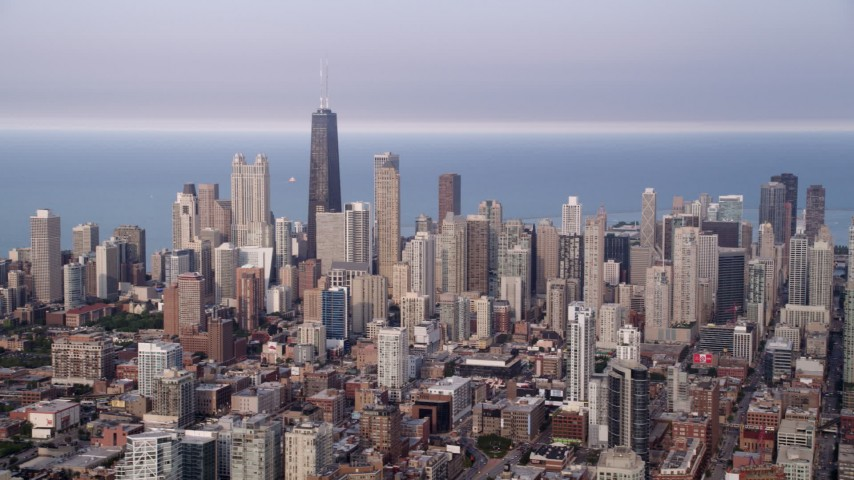 5K stock footage aerial video panning across Downtown Chicago skyscrapers, on a hazy day, Illinois Aerial Stock Footage | AX0001_067