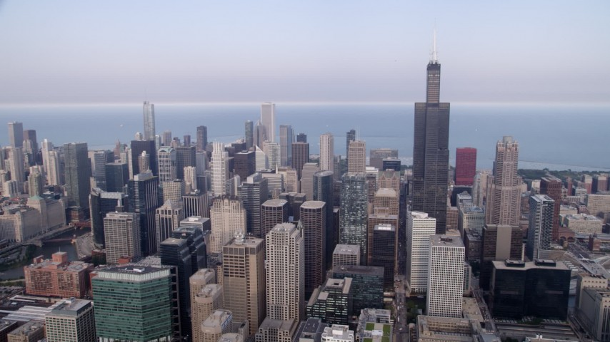 5K aerial of a view across Downtown Chicago on a hazy day, from Willis Tower to John Hancock Center, Illinois Aerial Stock Footage | AX0001_069