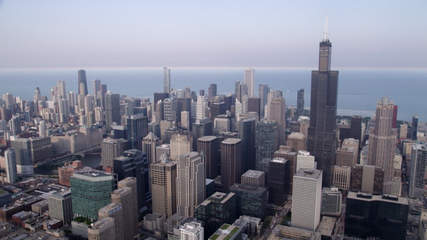 5K stock footage aerial video Downtown Chicago skyscrapers and Willis Tower on a hazy day, Illinois Aerial Stock Footage | AX0001_070