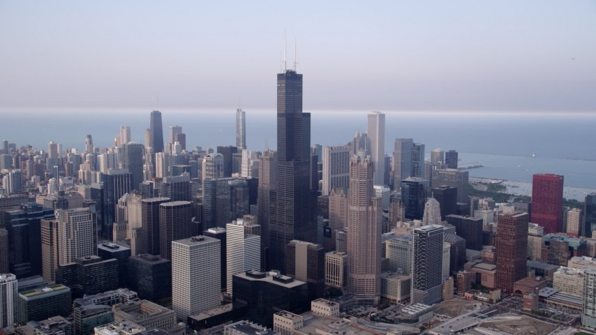 5K aerial video Downtown Chicago skyscrapers around Willis Tower on a hazy day; Chicago, Illinois Aerial Stock Footage | AX0001_071