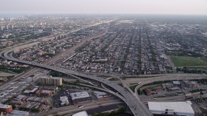 5K stock footage aerial video approaching Interstate 90, 94, and 55 interchange, urban neighborhood, South Chicago, Illinois Aerial Stock Footage | AX0001_075