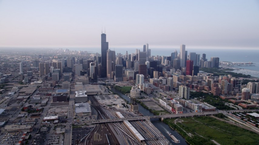 5K stock footage aerial video following the Chicago River toward Willis Tower and Downtown Chicago skyline, Illinois Aerial Stock Footage | AX0001_077