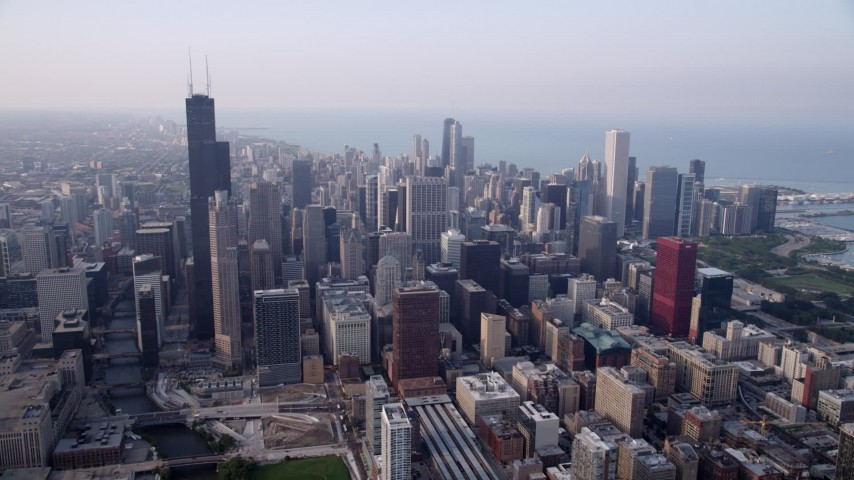 5K stock footage aerial video approach Willis Tower and Downtown Chicago buildings on a hazy day, Illinois Aerial Stock Footage | AX0001_079
