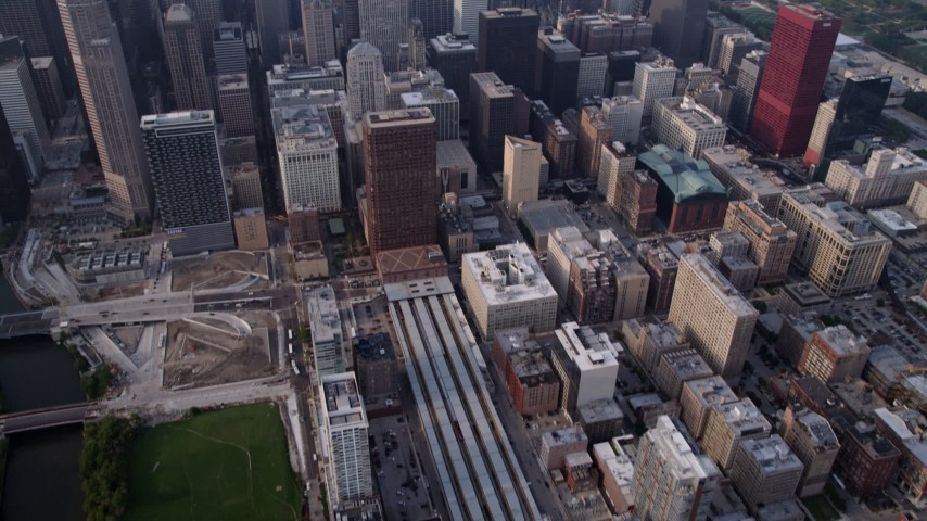 5K stock footage aerial video tilt from LaSalle Street Station, revealing Downtown Chicago skyscrapers on a hazy day, Illinois Aerial Stock Footage | AX0001_080