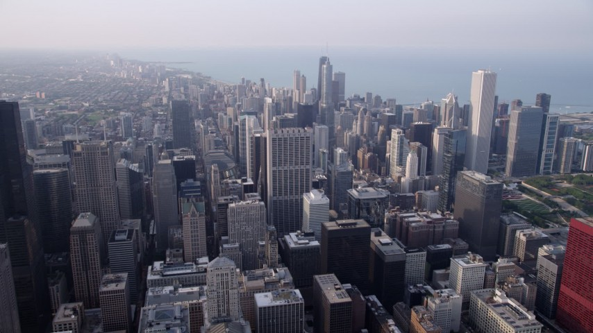 5K aerial  video approach Downtown Chicago skyscrapers on a hazy day, Illinois Aerial Stock Footage | AX0001_081