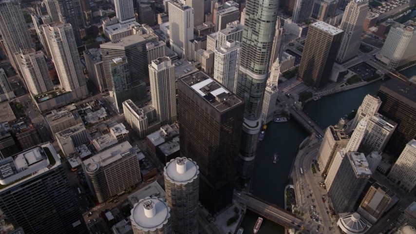 5K stock footage aerial video of Bird's eye of Marina City and Chicago River, tilt up revealing skyscrapers, on a hazy day, Illinois Aerial Stock Footage AX0001_084 | Axiom Images