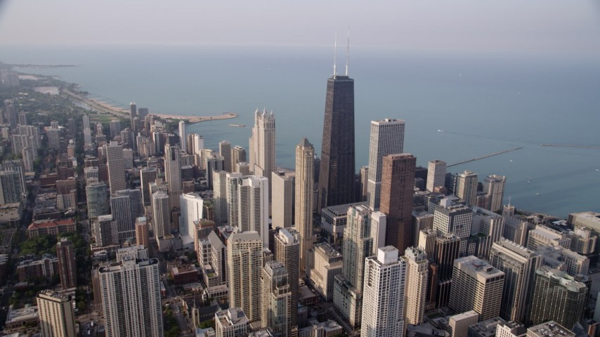 5K aerial stock footage video approaching John Hancock Center, Lake Michigan, Downtown Chicago, Illinois Aerial Stock Footage | AX0001_085