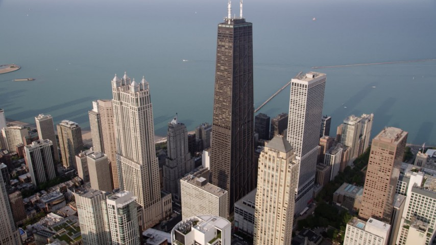 5K stock footage aerial video tilt from high-rises to reveal John Hancock Center, Lake Michigan, Downtown Chicago, Illinois Aerial Stock Footage | AX0001_086