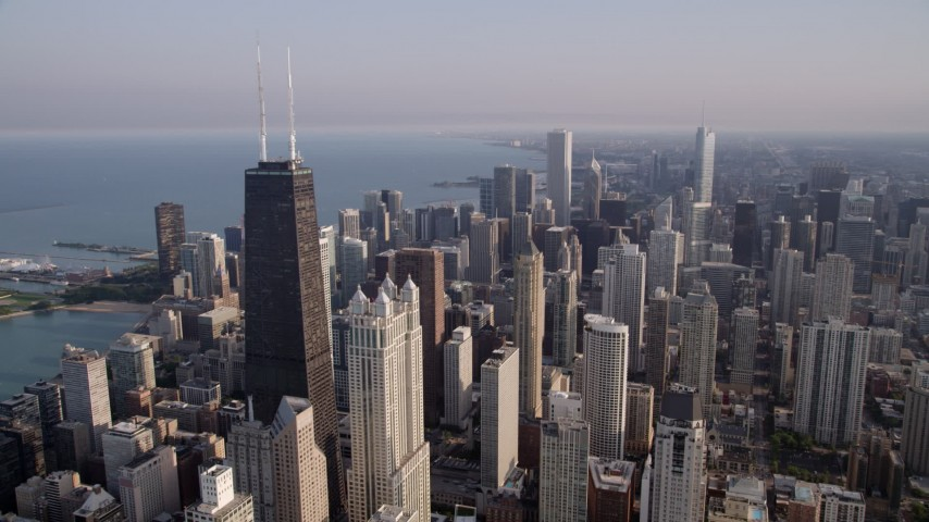 5K stock footage aerial video orbit John Hancock Center, revealing Downtown Chicago skyscrapers, on a hazy day, Illinois Aerial Stock Footage | AX0001_088