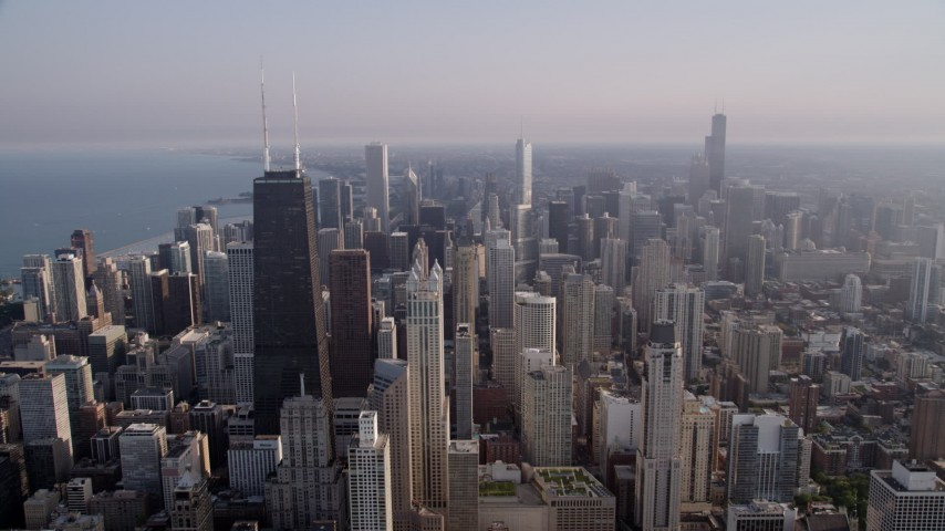 5K stock footage aerial video flying by John Hancock Center and downtown high-rises in Downtown Chicago, Illinois Aerial Stock Footage | AX0001_089