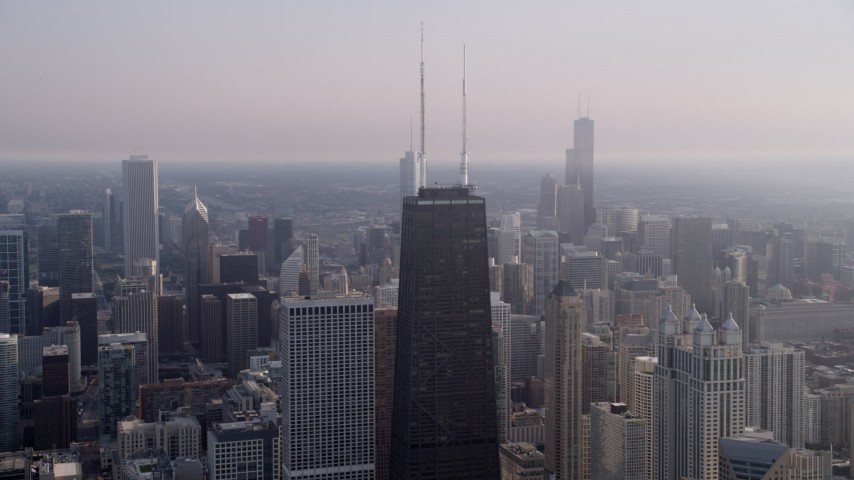 J5K stock footage aerial video of John Hancock Center on a hazy day, Downtown Chicago, Illinois Aerial Stock Footage | AX0001_090