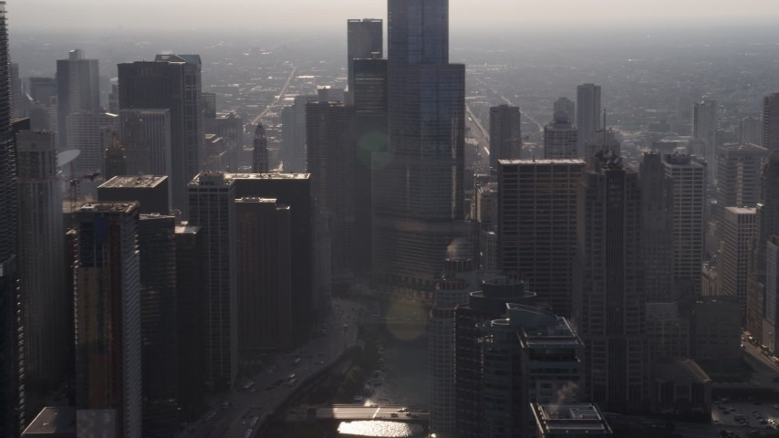 5K stock footage aerial video passing the Chicago River and downtown skyscrapers on a hazy day, Downtown Chicago, Illinois Aerial Stock Footage | AX0001_093