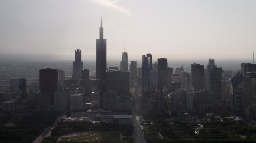5K stock footage aerial video of Willis Tower and skyscrapers in Downtown Chicago, Illinois Aerial Stock Footage | AX0001_095