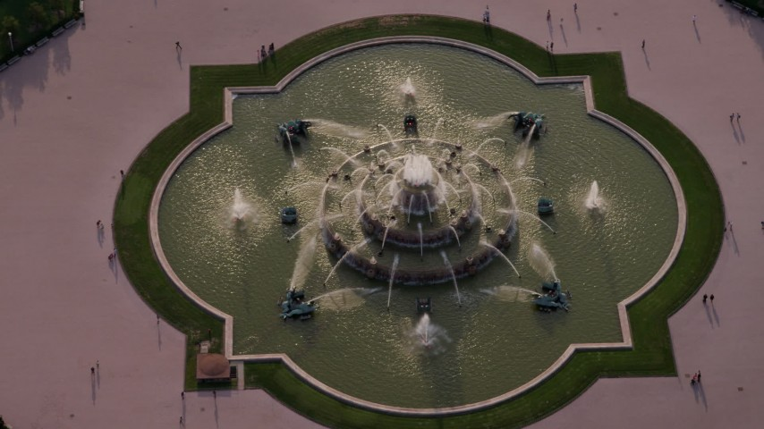 5K stock footage aerial video bird's eye view of Buckingham Fountain in Grant Park, Chicago, Illinois Aerial Stock Footage AX0001_098