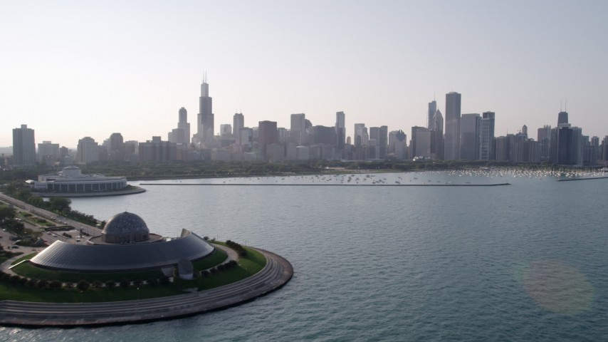 5K stock footage aerial video approach downtown skyline and harbor from Adler Planetarium, Downtown Chicago, Illinois Aerial Stock Footage | AX0001_100
