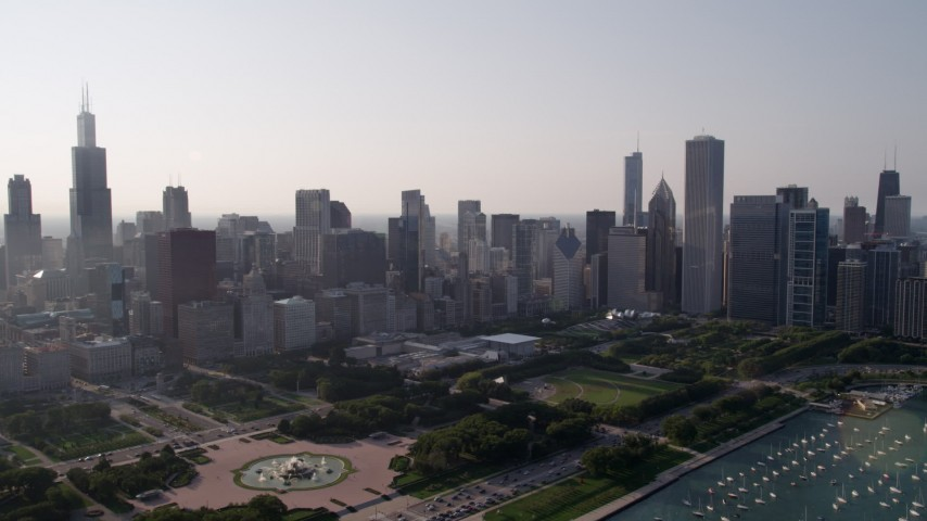 5K aerial stock footage video tilt from Lake Michigan, revealing the harbor, Grant Park, and Downtown Chicago skyline, Illinois Aerial Stock Footage | AX0001_101