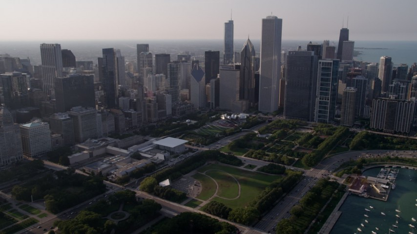 5K stock footage aerial video fly over Grant Park toward downtown skyscrapers, Downtown Chicago, Illinois Aerial Stock Footage | AX0001_102