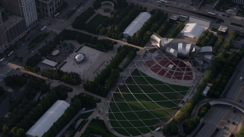 5K stock footage aerial video of the Cloud Gate sculpture at AT&T Park and Jay Pritzker Pavilion, Downtown Chicago, Illinois Aerial Stock Footage | AX0001_104