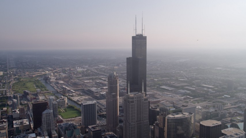 5K stock footage aerial video flying by Willis Tower, hazy day, Downtown Chicago, Illinois Aerial Stock Footage | AX0001_107