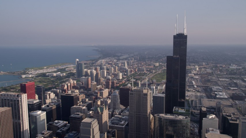 5K stock footage aerial video flyby Willis Tower with Lake Michigan in the background, Downtown Chicago, Illinois Aerial Stock Footage | AX0001_108