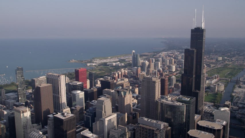 5K aerial video of Willis Tower and Downtown Chicago skyscrapers on a hazy day, Illinois Aerial Stock Footage | AX0001_109