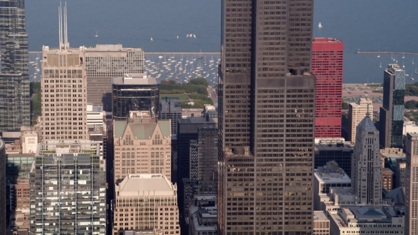 5K stock footage aerial video tilting up side of Willis Tower, Downtown Chicago, Illinois Aerial Stock Footage | AX0001_111