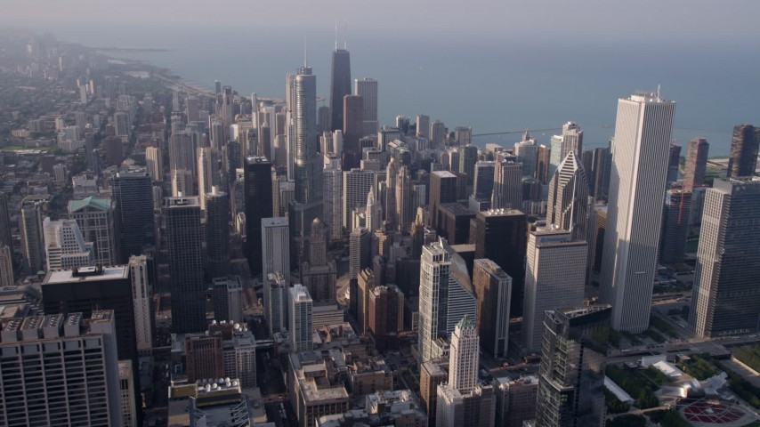 5K stock footage aerial video fly over downtown to approach skyscrapers and the lake in Downtown Chicago, Illinois Aerial Stock Footage | AX0001_115