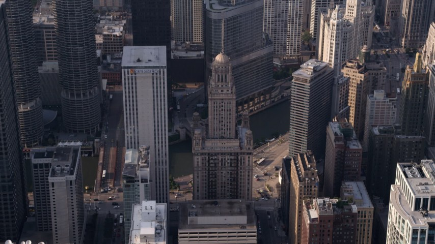 5K stock footage aerial video tilting down on Kemper Building and 35 East Wacker in Downtown Chicago, Illinois Aerial Stock Footage | AX0001_116