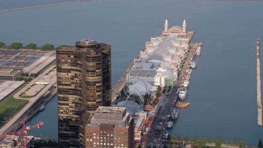 5K stock footage aerial video flying by Lake Point Tower and Navy Pier, Downtown Chicago, Illinois Aerial Stock Footage | AX0001_119