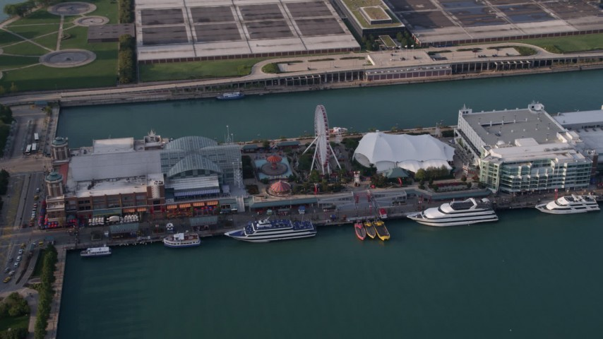 5K stock footage aerial video of Ferris Wheel on Navy Pier in Chicago, Illinois Aerial Stock Footage | AX0001_122