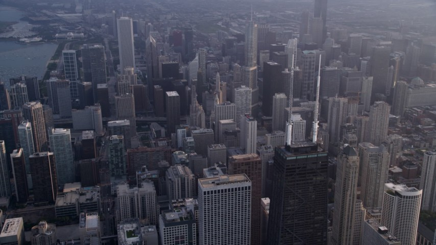 5K stock footage aerial video of the top of John Hancock Center and Downtown Chicago skyscrapers, on a hazy day, Illinois Aerial Stock Footage | AX0001_127
