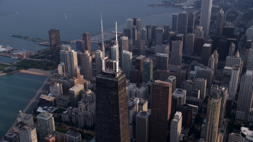 5K stock footage aerial video of the top of John Hancock Center and downtown Chicago skyscrapers, Illinois Aerial Stock Footage | AX0001_128