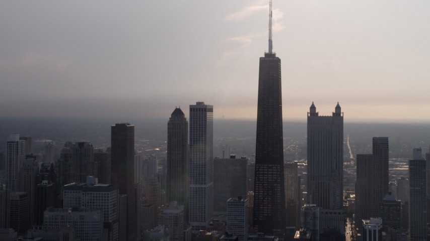 5K stock footage aerial video tilt up from Lake Michigan to reveal John Hancock Center and skyscrapers, Downtown Chicago, Illinois Aerial Stock Footage | AX0001_129