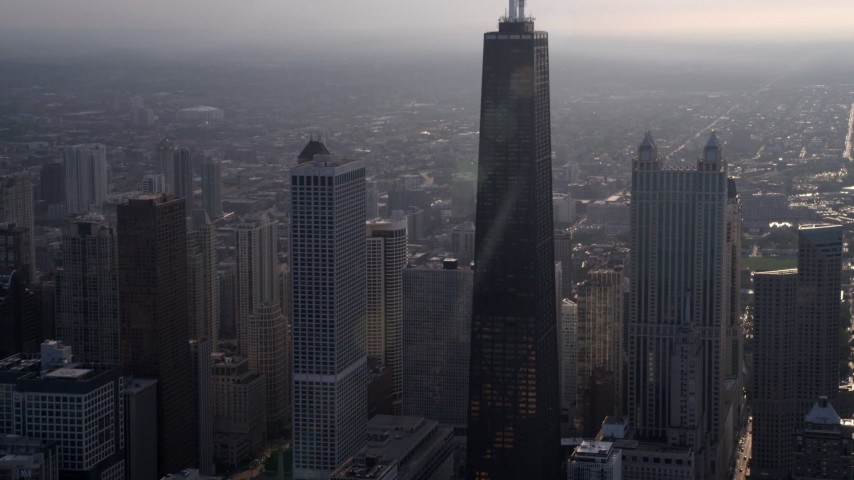 5K stock footage aerial video flying toward John Hancock Center on a hazy day, Downtown Chicago, Illinois Aerial Stock Footage | AX0001_130